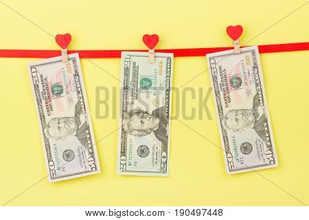 Fifty Dollars, Twenty Dollars On The Clothespins