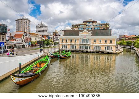 AVEIRO,PORTUGAL - MAY 12,2017 - View at the canal with Aveiro municipality building. Aveiro is located on the shore of the Atlantic Ocean.Aveiro is an industrial city with an important seaport.