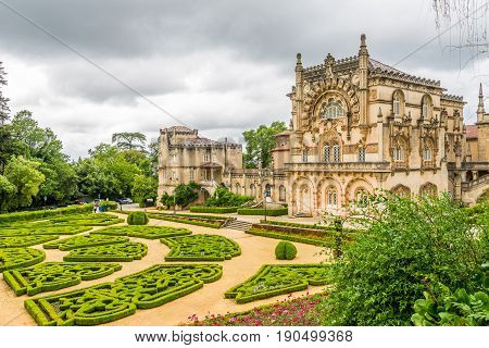BUCACO,PORTUGAL - MAY 12,2017 - View at the Palace of Bucaco with garden in Portugal. Palace was built in Neo Manueline style between 1888 and 1907.