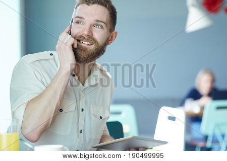 Happy trader talking on mobile phone