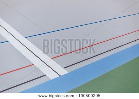 Finish line on professional cycle track. Velodrome of white color.