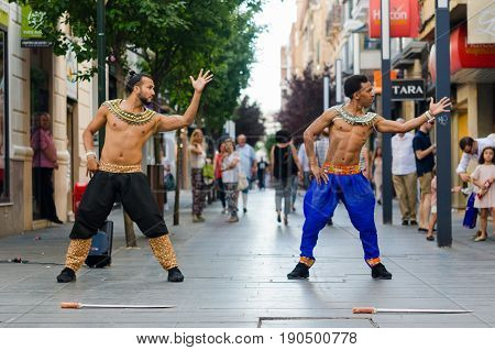 Badajoz, Spain - june 09 2017: Two man bollywood dancers are performing in the streets Menacho of Badajoz