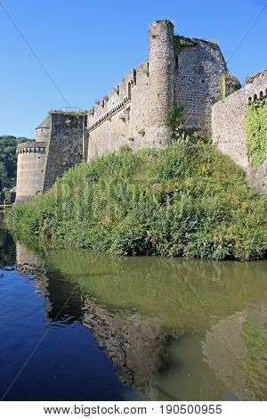 Fougeres Castle, France reflected in the moat