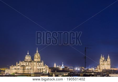 Night view of Salamanca cityscape, with the Cathedral on the left and the Pontifical University on the right side. The Old city of Salamanca is declared by UNESCO a World Heritage Site.