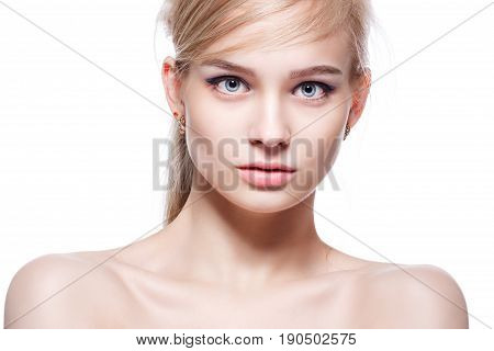 Beautiful young blonde woman with delicate make-up.
