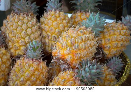 Fresh Pineapples At Fruit Market. Top View. Close-up