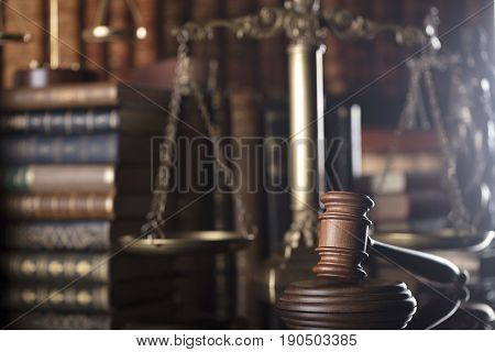 Law theme.  Mallet of the judge, justice scale, books in the court library.