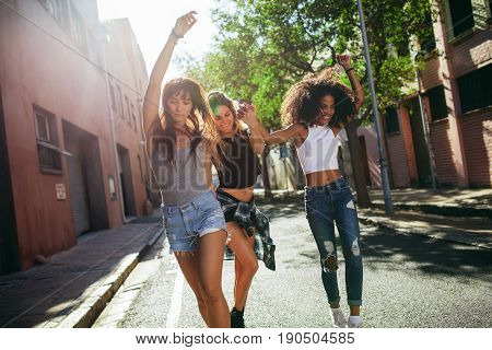 Beautiful Women Having Fun On City Street