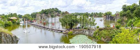 Dong Nai, Vietnam - June 4th, 2017: Panorama ecotourism area with a bridge over peninsula in large lake with many small islands attract tourists to resort on the weekend in Dong Nai, Vietnam