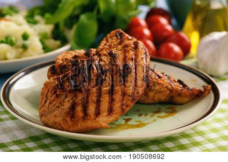 Grilled turkey fillet with mashed potatoes .