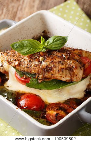 Balsamic Chicken Fillet Baked With Caprese Close-up In A Baking Dish. Vertical