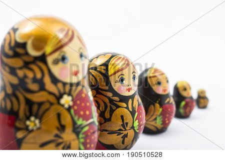 a group of traditional russian nesting dolls