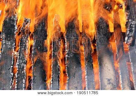Building close up engulfed in flames makes a Structure Fire Background