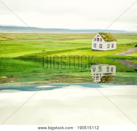 lonely house near the sea lonely house with mirroring in the water surface