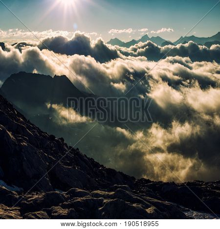 sunrise in alps ovwr the peaks and clouds nature background concept