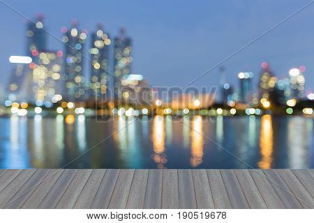 Blue twilight night view Office building blurred bokeh light opening wooden floor abstract background