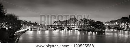 Black & White panoramic of Ile de la Cite the Seine River and Pont Neuf at Dawn. Paris 1st Arrondissement France