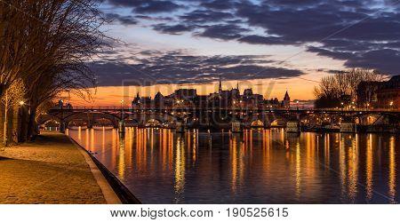 Sunrise on Ile de la Cite and the Seine River with view of Pont des Arts. 4th Arrondissement. Paris France