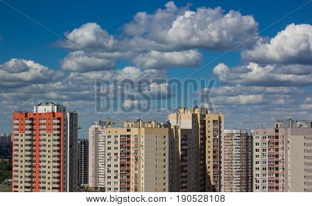 cityscape. new modern housing in urban city against the background of the blue sky and clouds
