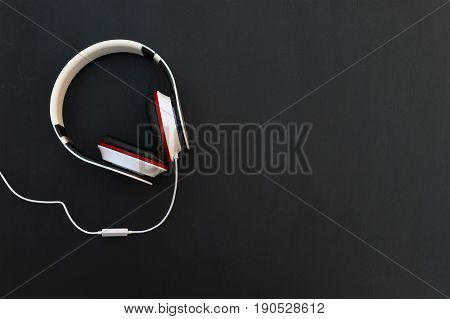 Headphone . headphone on wood table. Fashionable headphone on black background.