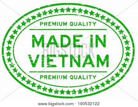 Grunge green premium quality made in Vietnam oval rubber seal stamp on white background