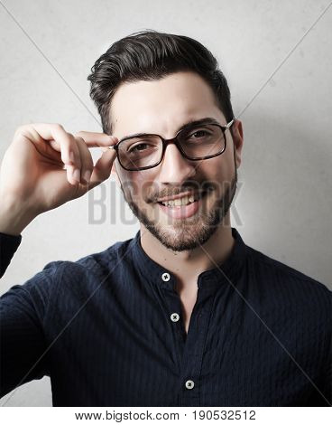 Handsome young man wearing glasses and a shirt