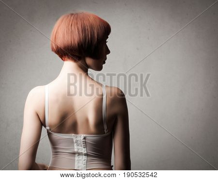 Young woman with bob cut showing her back