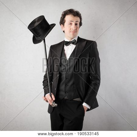 Elegantly dressed man with top hat and walking stick