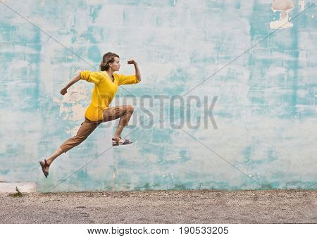 Fit girl running and jumping