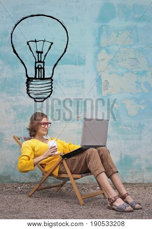 Clever girl with brilliant ideas using a laptop