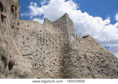 Outdoor artificial climbing wall on a nice day