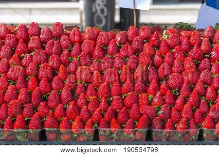 Fresh strawberries on a street cart market in Athens, Greece.Concept for travel, urban and street life, fresh, healthy, raw, easy accessible food and small family business