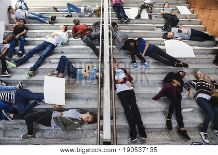 Group of exhausted students sleeping on stairways