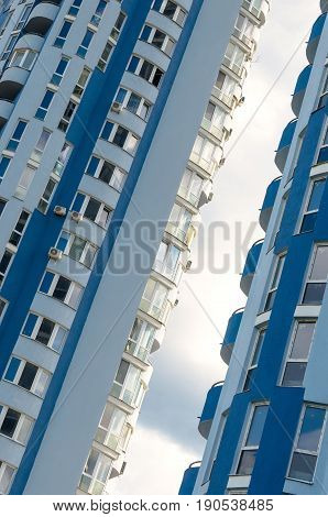 Tall residential building skyline. High-rise buildings modern architecture.