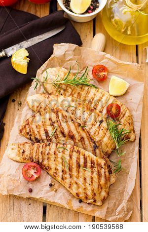 Grilled pork escalopes with rosemary lemon and cherry tomatoes