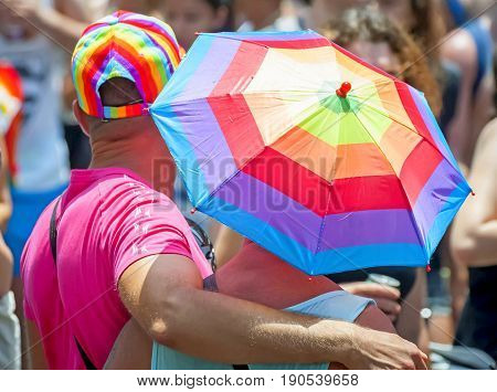 TEL AVIV, ISRAEL. June 9, 2017. Unknown gay couple taking part in the Tel Aviv Gay Pride parade 2017.