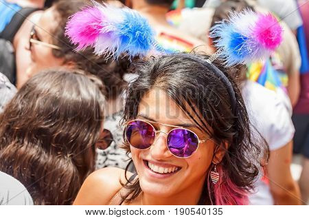 TEL AVIV, ISRAEL. June 9, 2017. Unknown girl taking part in the Tel Aviv Gay Pride parade 2017. It was devoted to the bisexual people. Bisexual pride flag has three colors: pink, lavender, blue.