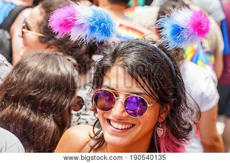 TEL AVIV, ISRAEL. June 9, 2017. Unknown girl taking part in the Tel Aviv Gay Pride parade 2017. It was devoted to the bisexual people. Bisexual pride flag has three colors: pink, lavender, blue.