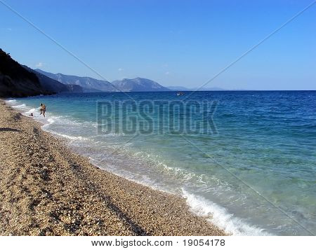 Idillyc beach with turquoise waters and pebbles