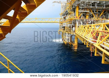 Offshore construction platform for production oil and gas. Oil and gas industry and hard work industry. Production platform and operation process by manual and auto function from control room.