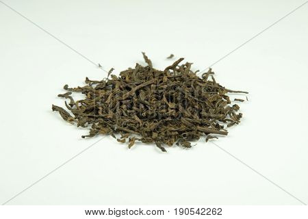 Close-up view of fermented tea leaves isolated on white background