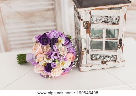 beautiful Wedding bouquet of fresh violet flowers on a white background. Wedding decor concept.