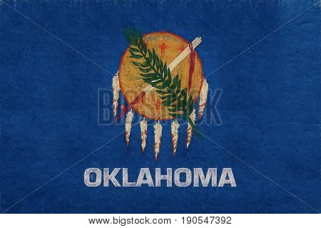 Illustration of the flag of Oklahoma state in America with a grunge look.