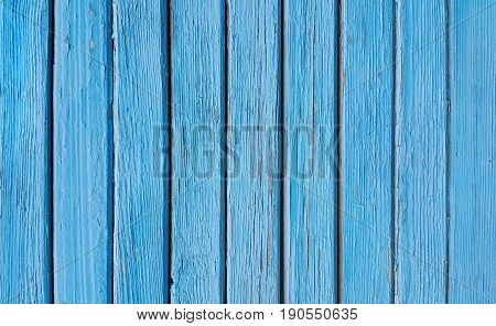 Texture of old wooden blue fence close-up