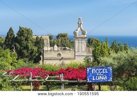 CAPRI, ITALY - MAY 21, 2017: view of Certosa di San Giacomo, Carthusian monastery and signpost to the entrance to the hotel Luna, Bay of Naples in Southern Italy
