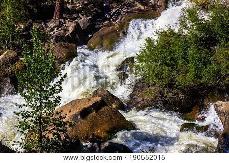 Rushing Waters Down Mountain Stream From Snow Melting In The Mountains