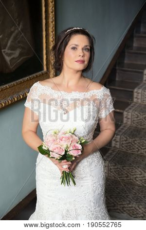 Bride With White Dress And Pink Flowers