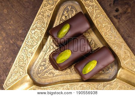 Handmade Luxury Chocolates With Pistachio. Top View
