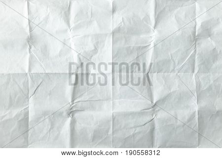 White sheet of paper folded. Crushed and folded white sheet of old paper. Note paper. Wrinkled paper.