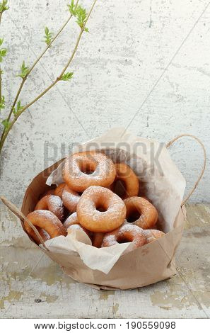 Sweet ruddy donuts with sugar icing in the package